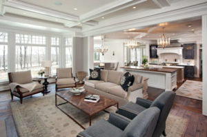 Interesting architectural details create an upscale look to this open kitchen and living area.