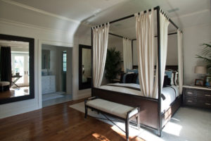 An ensuite bedroom offers the convenience of a connected bathroom.